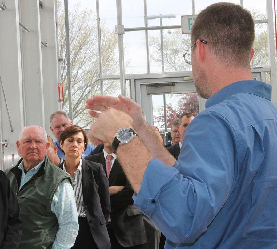 Sonny Perdue listens at Corteva Agriscience
