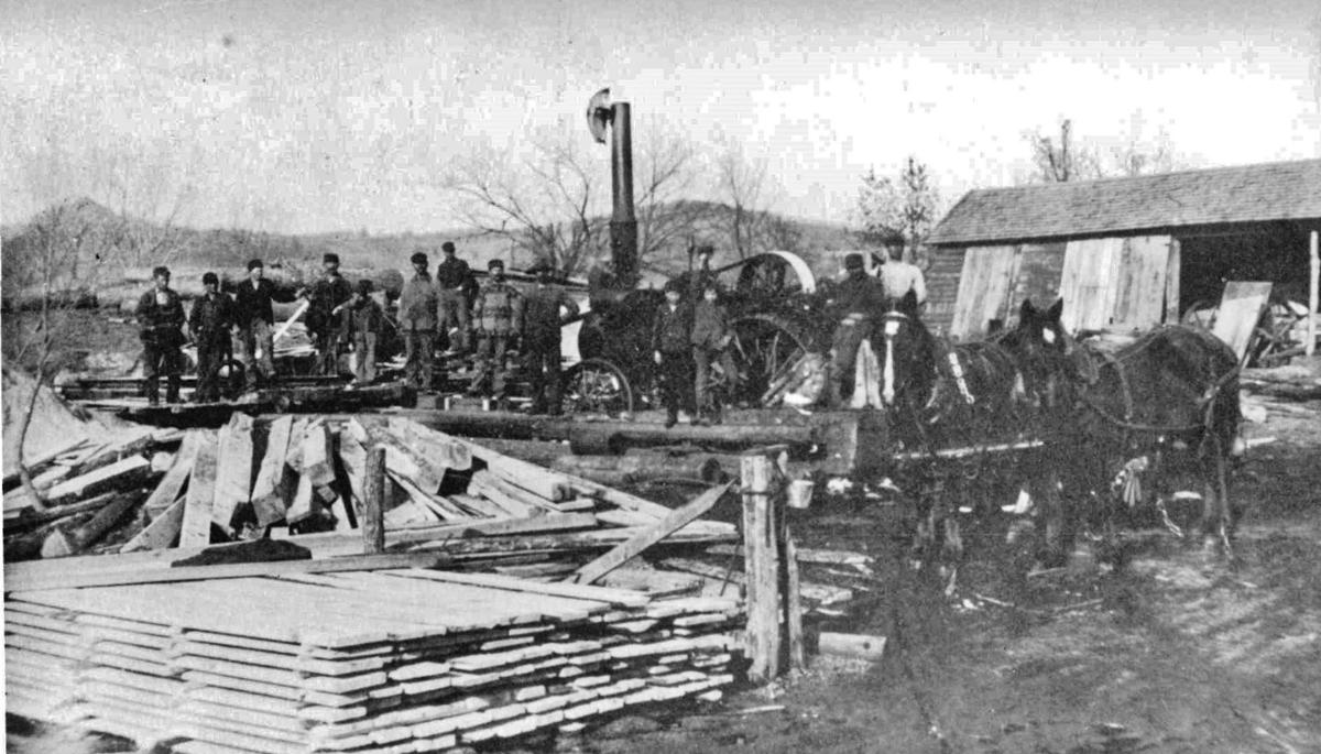 Workers congregate in 1908 at Charles Benjamin's sawmill in Misha Mokwa, Wisconsin.