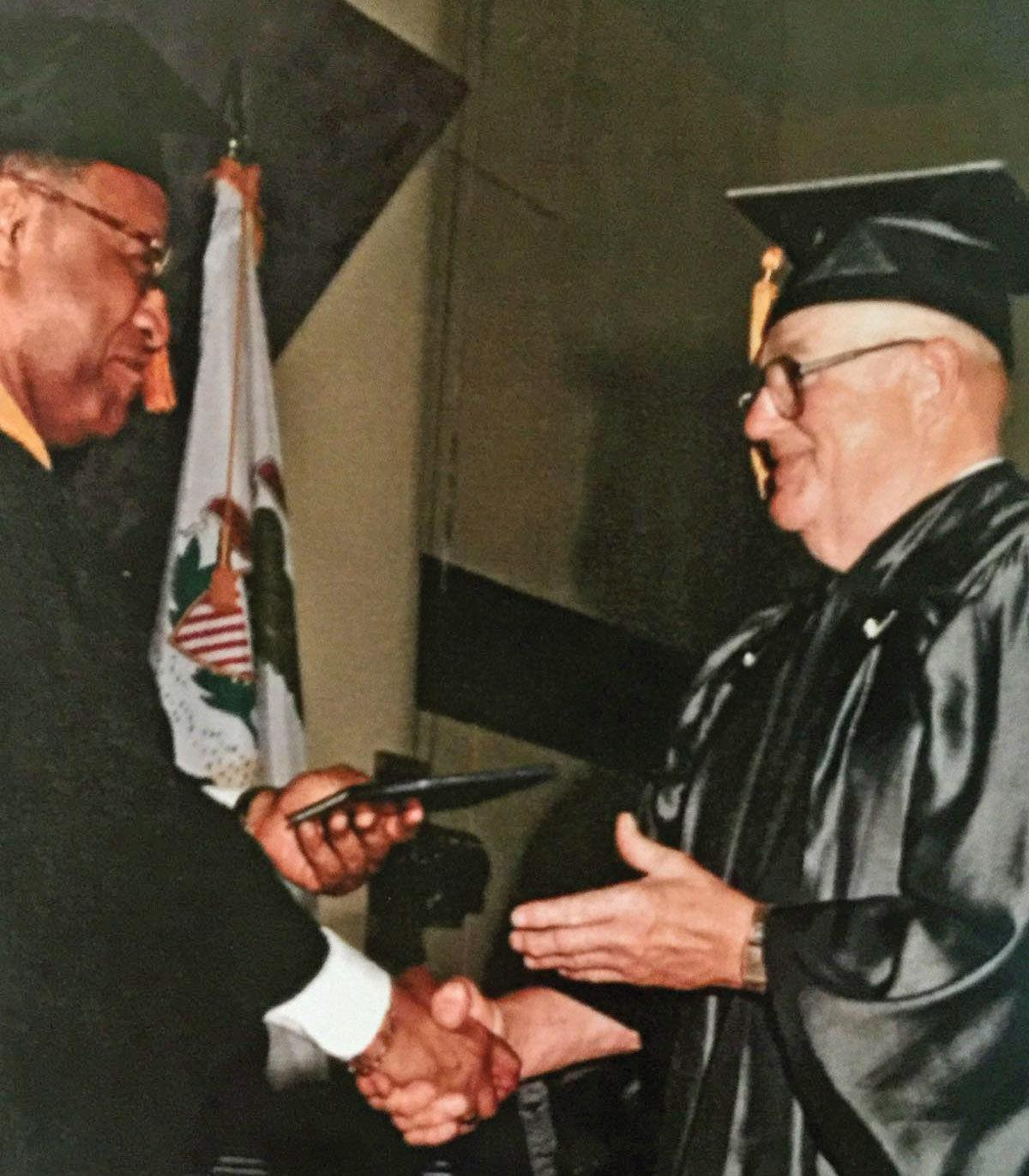 Dick Smerz, a Korean War Navy veteran graduates
