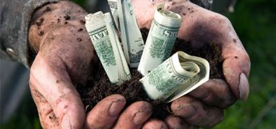 Hands with dirt and money in them