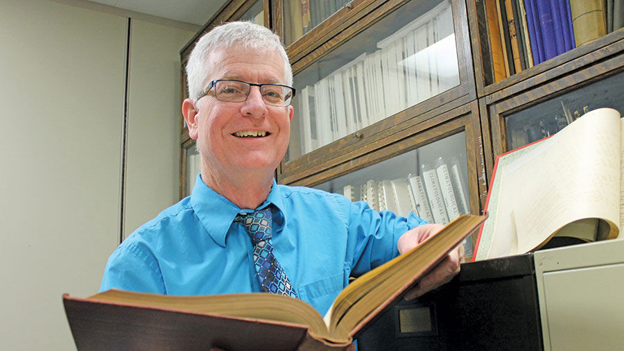 Iowa state climatologist retires from 30 year career state retiring state climatologist harry hillaker digs through old books of iowas weather history sciox Image collections