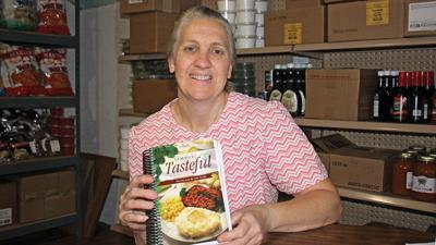 Valerie Yoder with cookbook