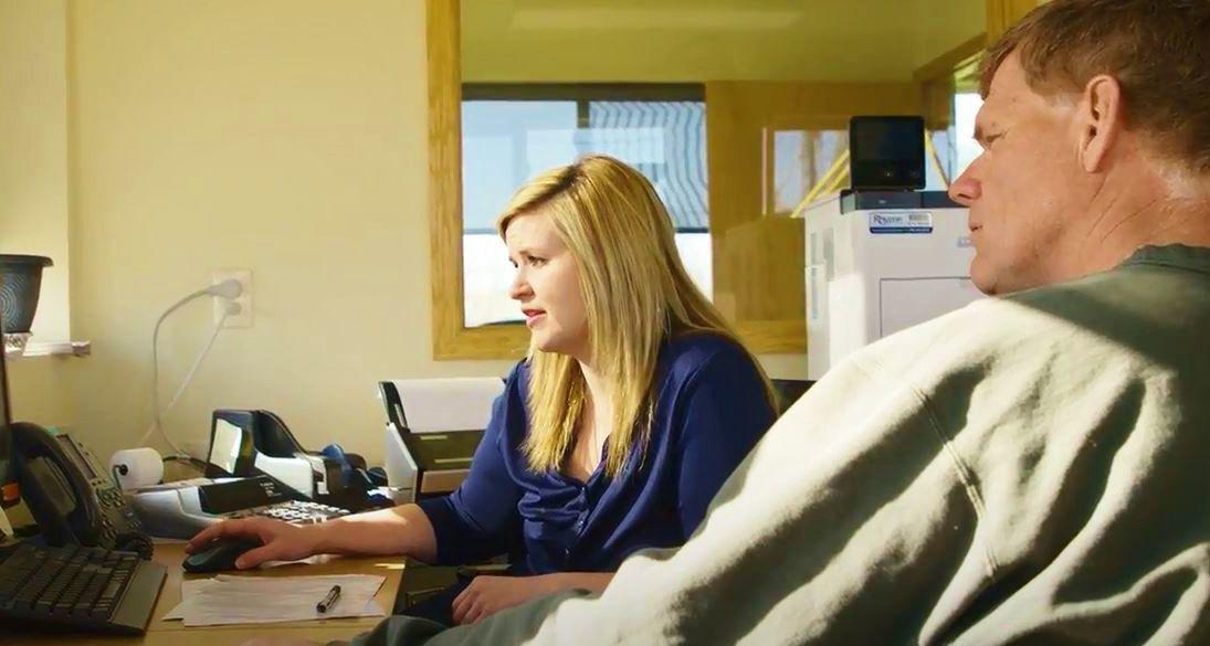 Katie Demrow working on grain-marketing program at Landmark Cooperative