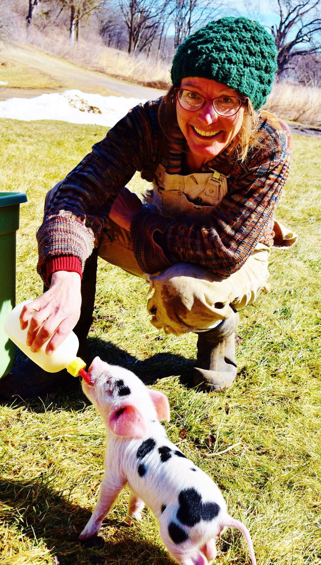 April Prusia with baby spot piglet