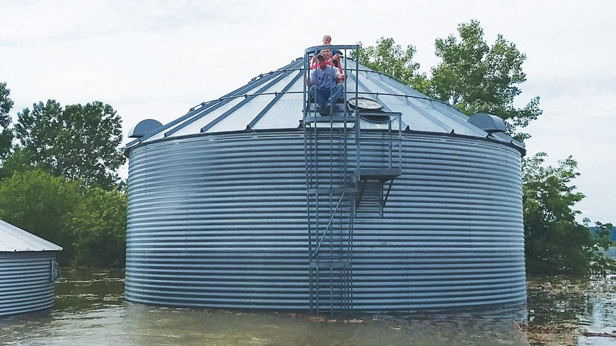Fraley grain bin surrounded by water