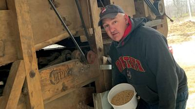 Dan Dietz cleans seed