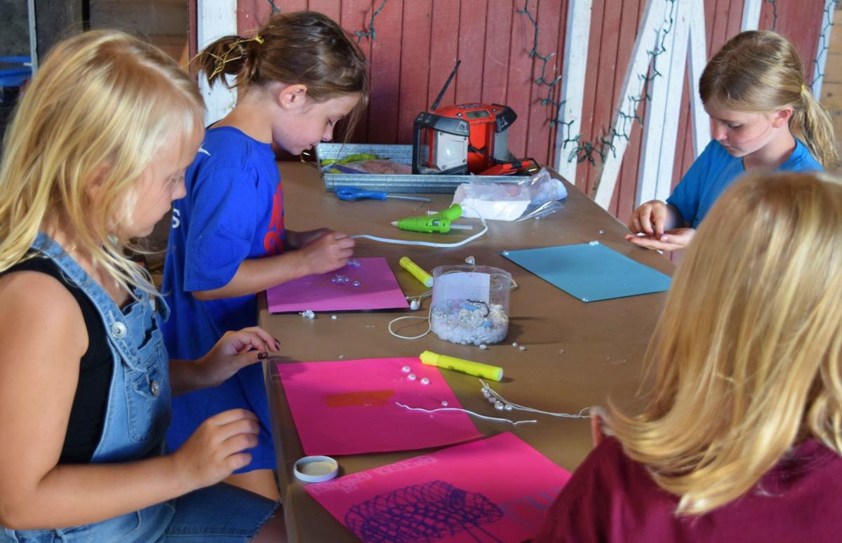 Daluge Farm Campers doing artwork