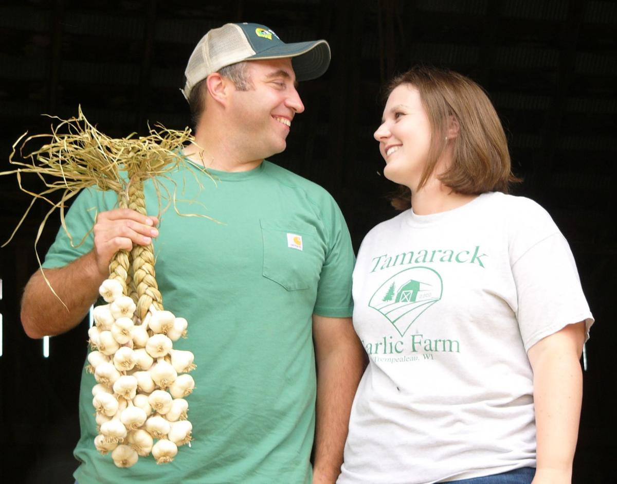 Jason and Molly Hovell with softneck garlic