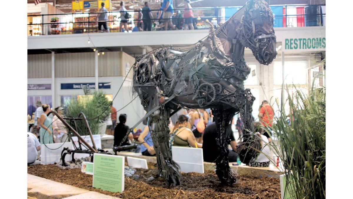 metal sculpture of a Percheron horse