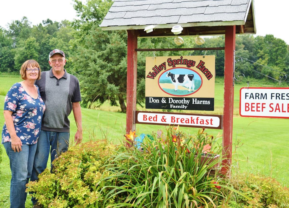 Dorothy and Don Harms with Valley Springs Farm Bed and Breakfast and beef sales signs