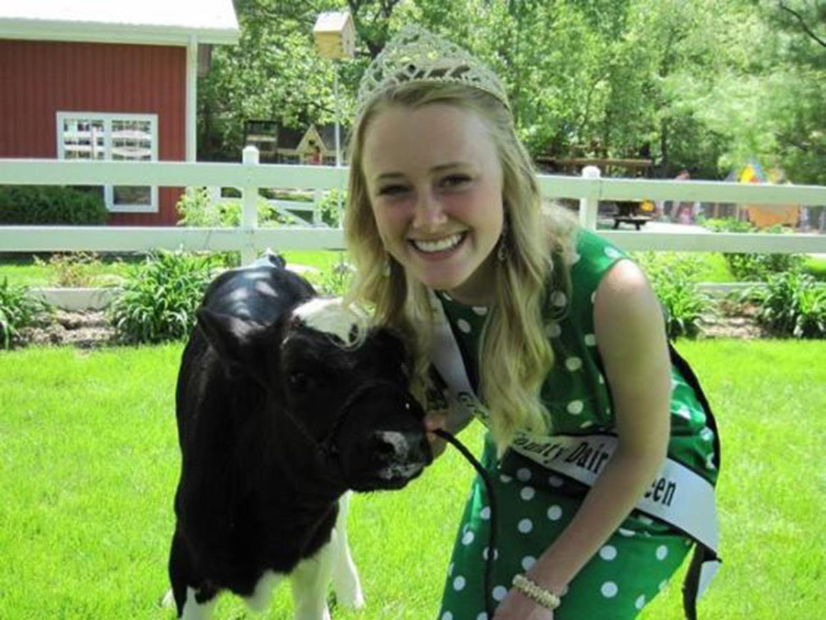 Mariah Martin bonds with a calf