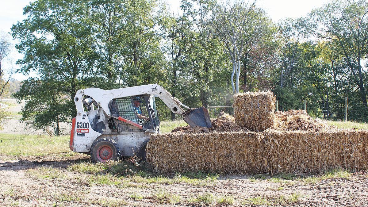 Temporary composting bins made of hay bales