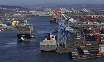 Container ship heads into port