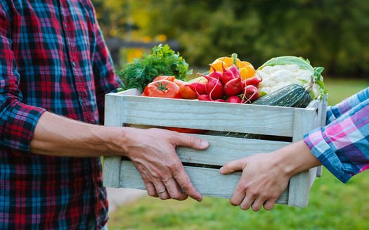 Box of produce changes hands