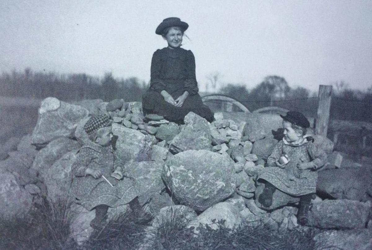 Wisconsin farm children play on rocks circa 1900.
