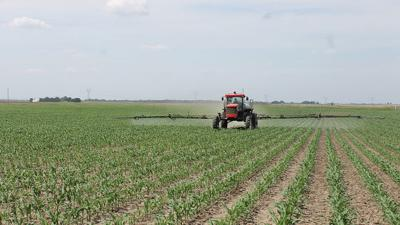 Larry Troyer spraying corn
