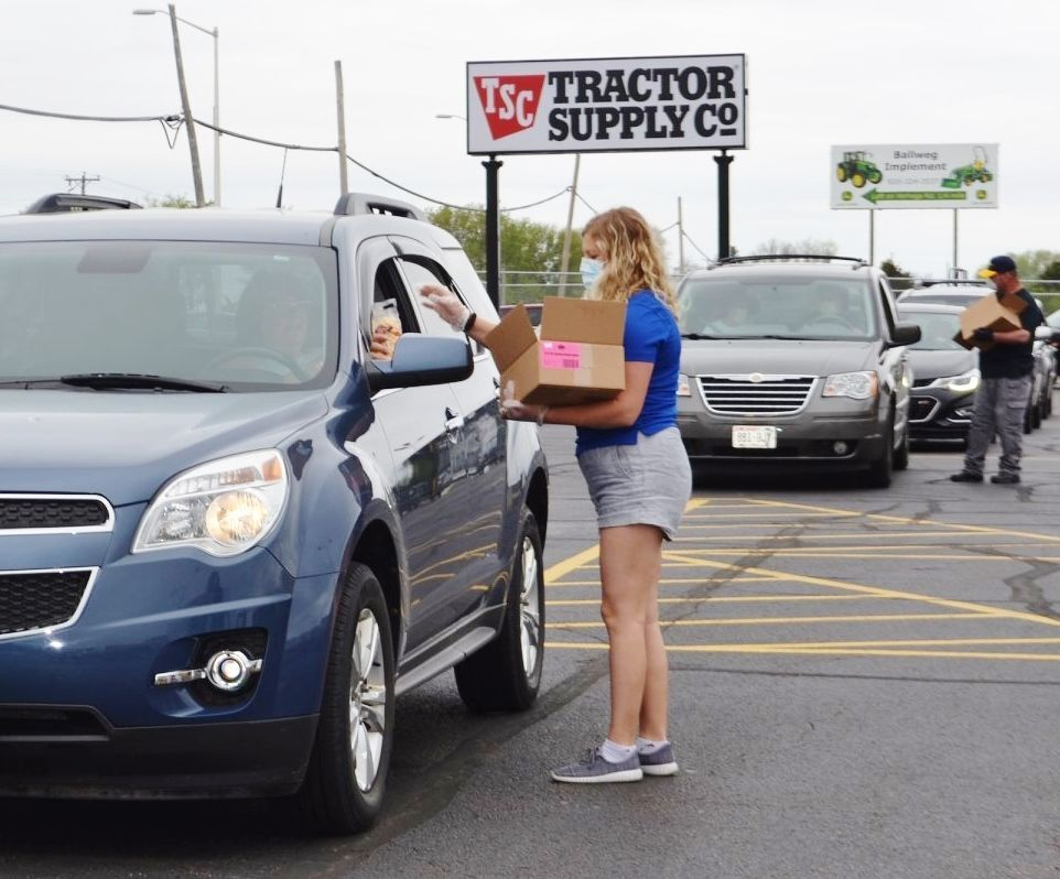 Cars line up for food in TSC parking lot