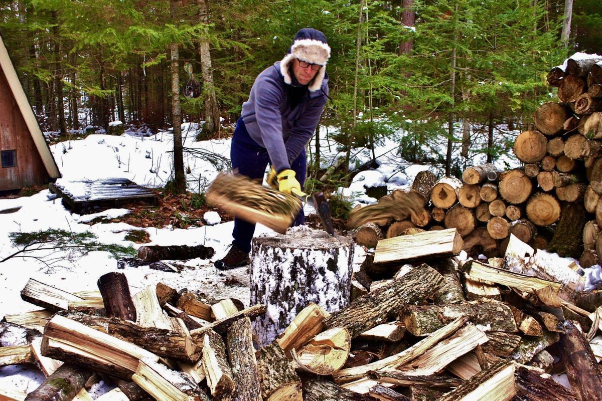 Jon Saverda splits wood