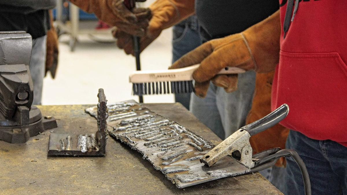 Students learn to weld in the new ag-industrial technology