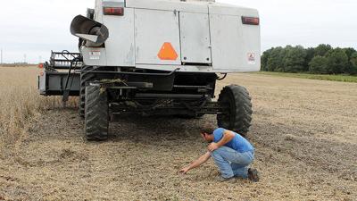 Kevin Thole checks on combine