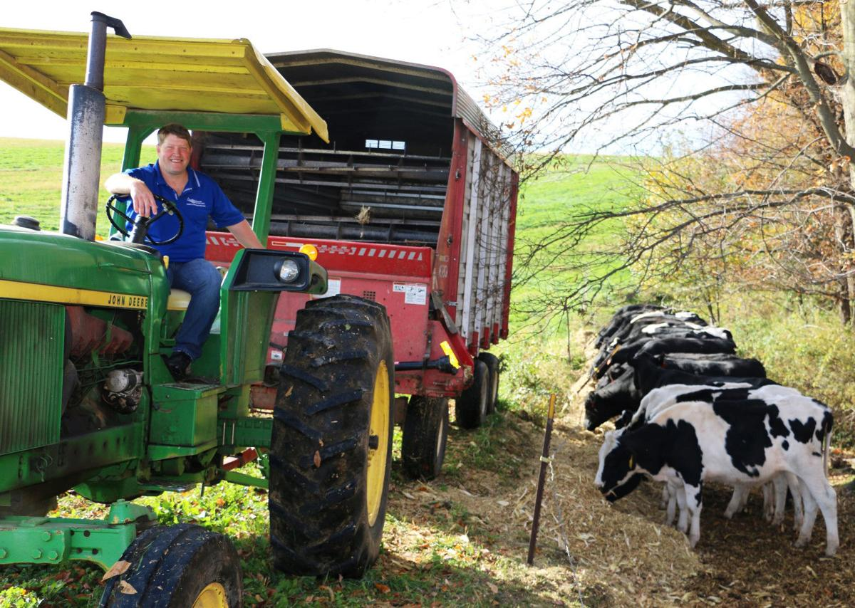 Darin Von Ruden feeding cattle