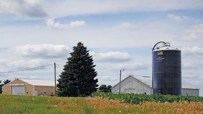 Farm photo with flag silo