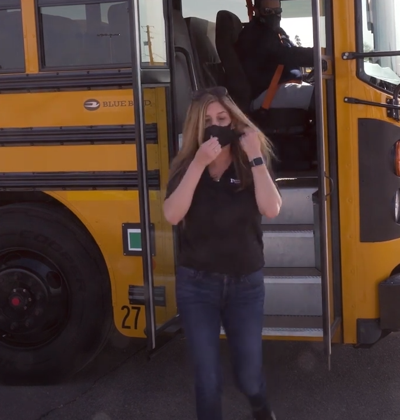 In May, Kyrene Superintendent Laura Toenjes wore a mask while riding a school bus.