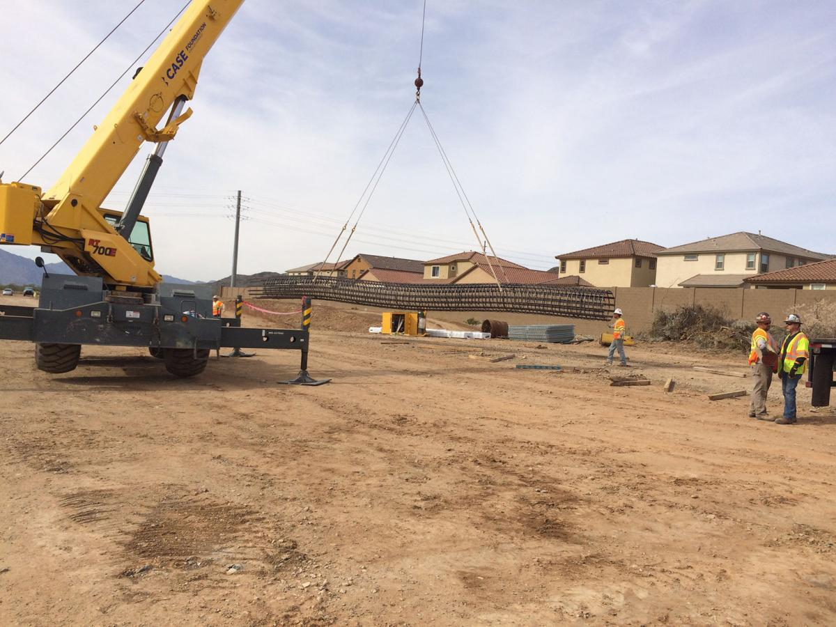 Crews earlier this year began laying infrastructure for Pecos Road bridges at 17th Avenue and 24th Street.