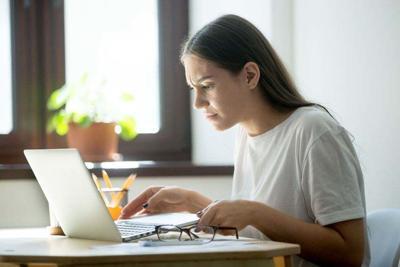 Fierce female shocked of instant laptop error