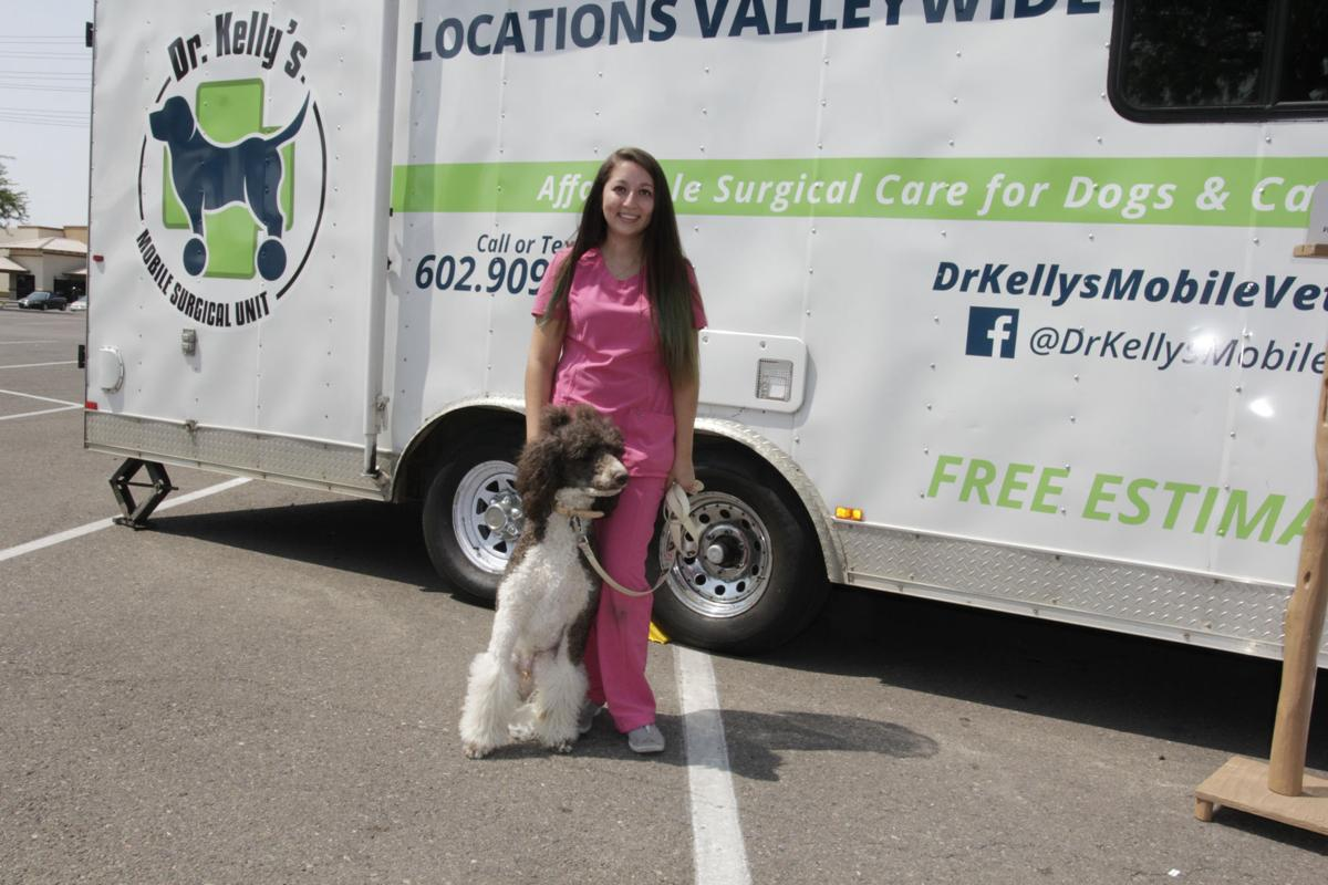 Mobile vet service nurse Brittany Paridon has another satisfied patient in Bumper.