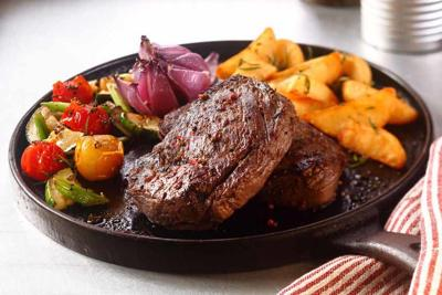 Appetizing Beef Steak with Veggies on Skillet