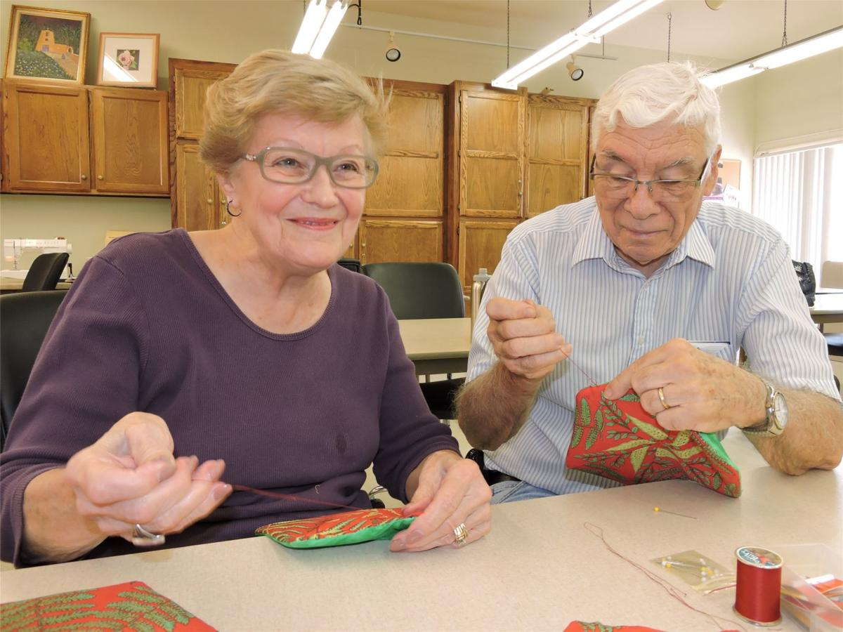 Sylvia Holt and Jim Snyder of the Saguaro Strippers Quilting Club make potholders