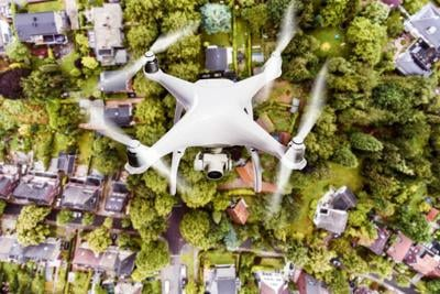 Hovering drone taking pictures of Dutch town. Aerial view.