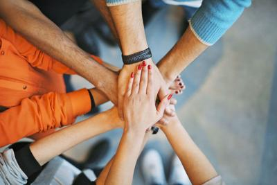 Stack of hands a symbol of teamwork