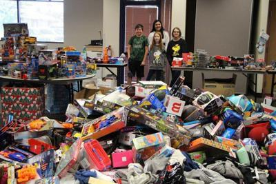One of the Kyrene Foundation's annual activities is helping to gather gifts for distribution to needy families in the district at Christmas time .