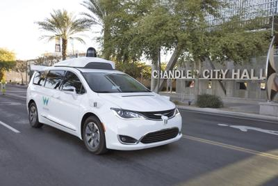 City workers getting a lift from Waymo vehicles