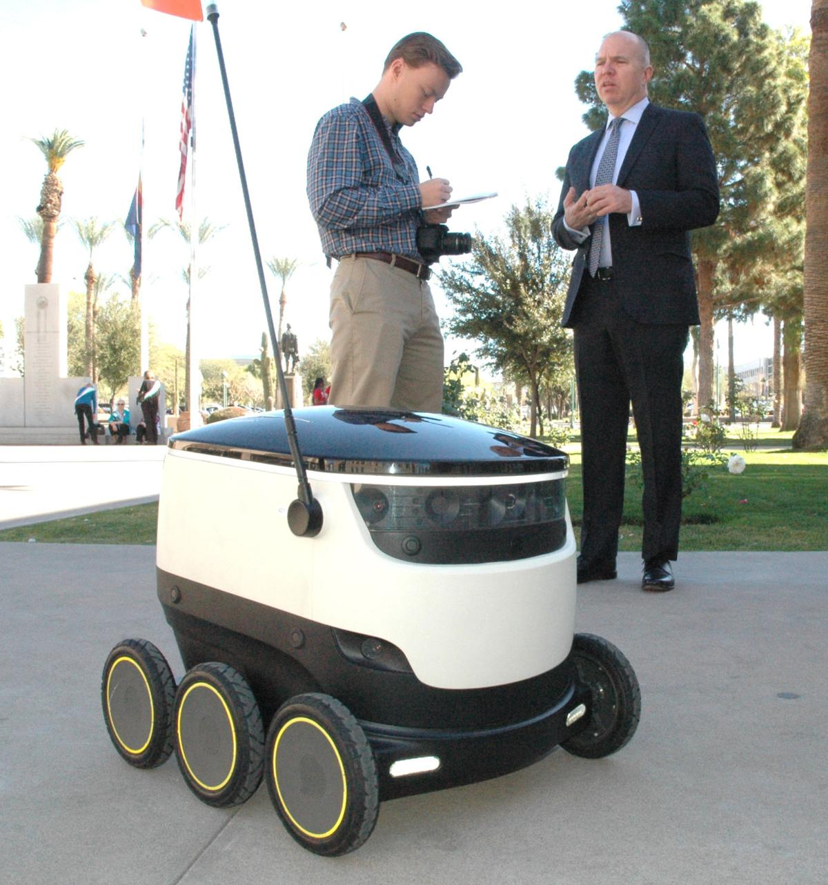 A reporter grills David Catania, spokesman for Starship Technologies, about the company's delivery drones.