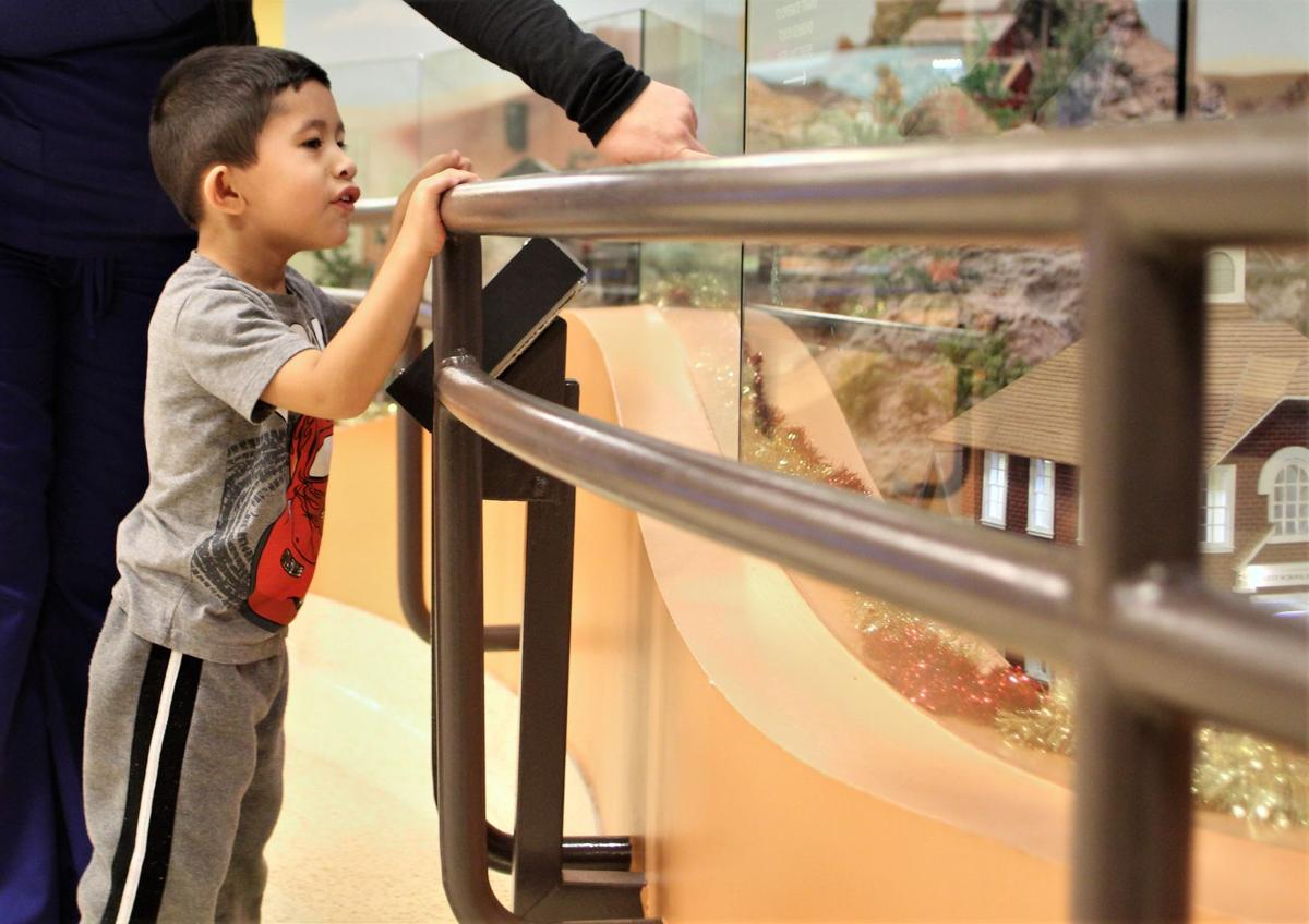 Jovanni Perez, 3, of Mesa, stares intently at the garden train display inside Cardon Children's Medical Center