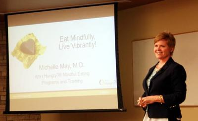 """Dr. Michelle May, a self-confessed """"recovered yo-yo dieter"""" now runs a successful business teaching people """"mindful eating"""" as a more effective way to lose weight than dieting."""