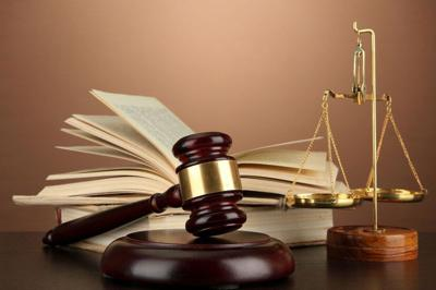 17291733 - golden scales of justice, gavel and books on brown background