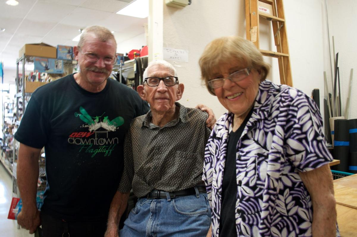 Long time customer and airline pilot Scott Williamson, left, with the late Leonard Branstetter and wife Karilyn Branstetter, owners of Plaza Hardware.