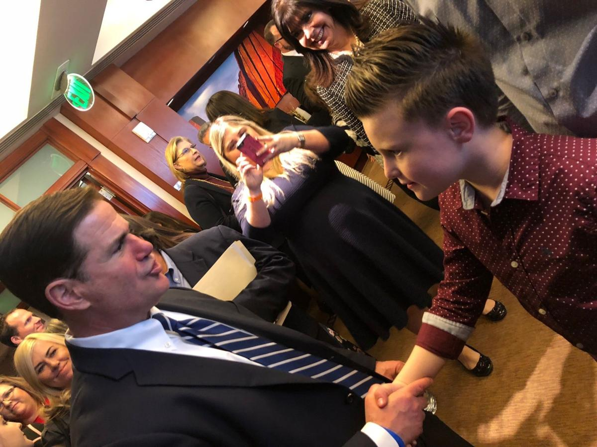 Gov. Doug Ducey gave Xavier Kennedy, 9, of Ahwatukee a handshake and the thanks of a grateful state for his compassionate act in sending a foster child to Harry Potter World.