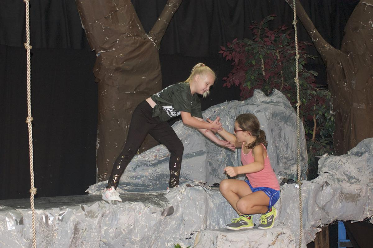 Abby Springer of Mesa, playing Young Terk, rehearses a scene with Ava Wright of Chandler, who plays young Tarzan.