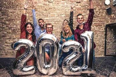 Happy New Year- Smiling People with silver balloons Celebrating New Year with face mask down in coronavirus time - New normal lifestyle concept about people have fun