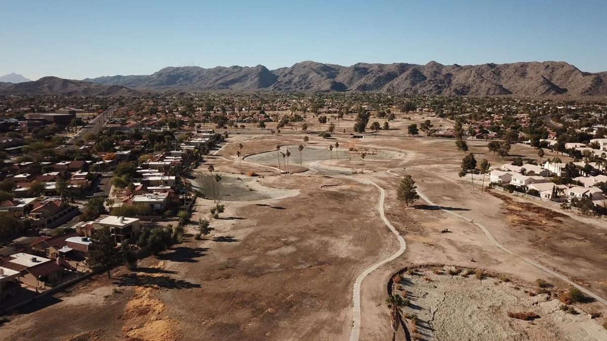 This drone-powered photo by Tom Sanfilippo of Inside Out Aerial shows the Ahwatukee Lakes Golf Course as it is today, stripped of any turf and its lakes nearly dried up.