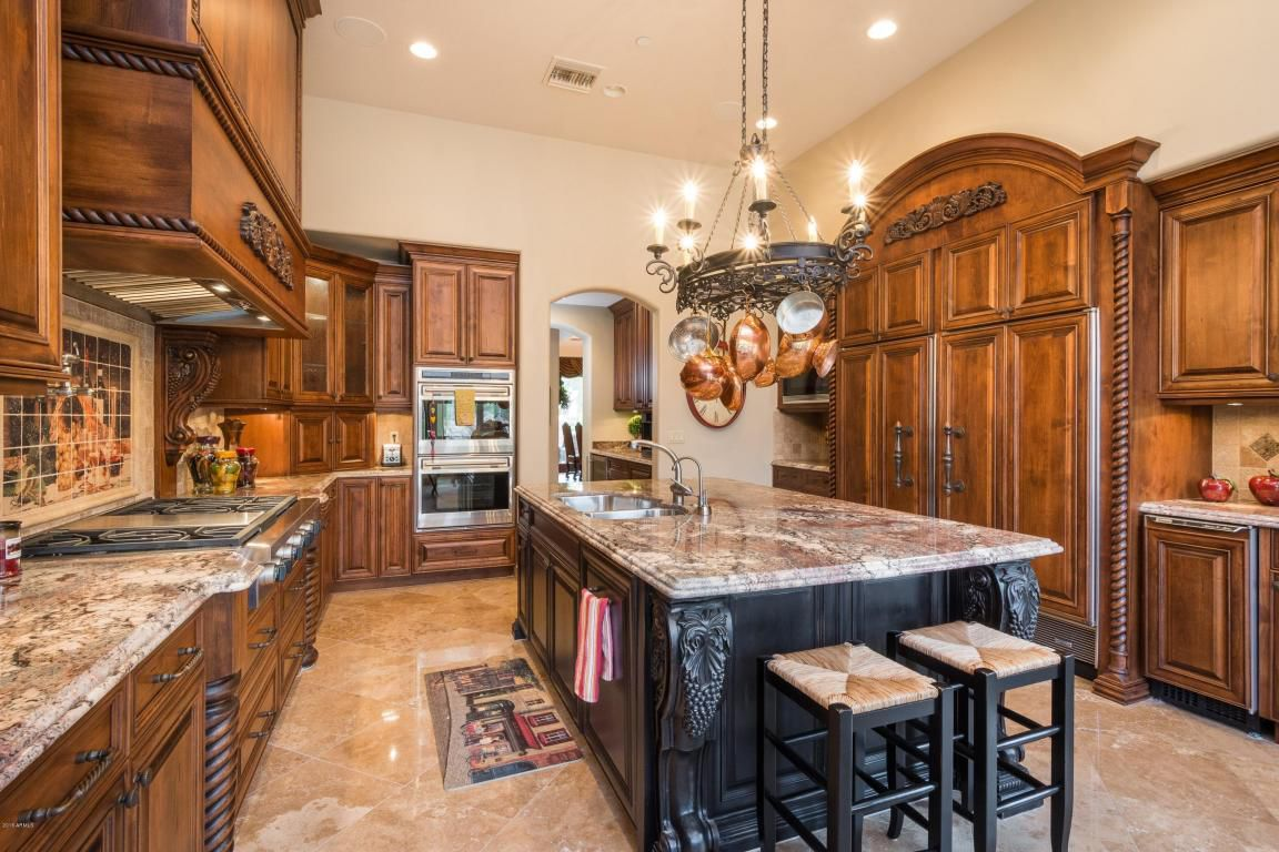 The gourmet kitchen includes top-of-the-line appliances and a butler's pantry