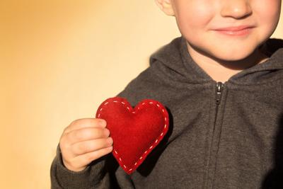 40083678 - red heart in child hands. kindness concept, gift, hand made valentine