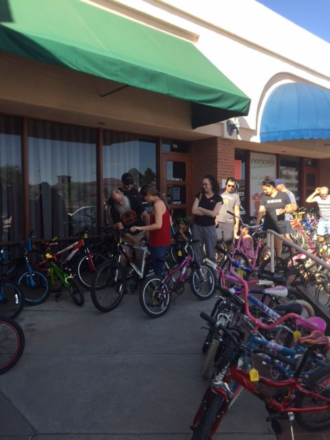 Customers at Odelay Bagel n Ahwatukee check out Handlebar Helpers' reconditioned bikes.