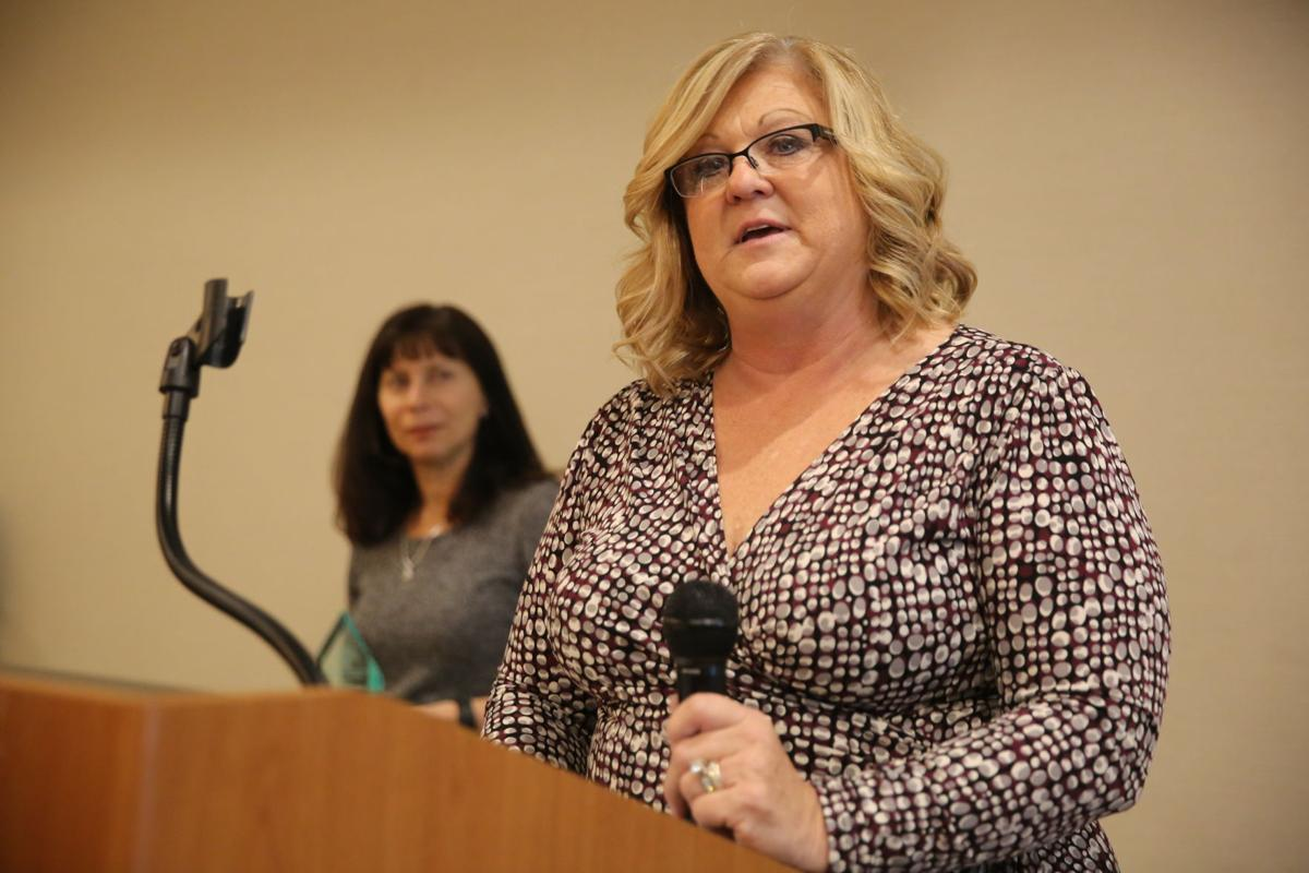 Janet Swchwab addresses the Ahwatukee Foothills Chamber of Commerce after winning the award