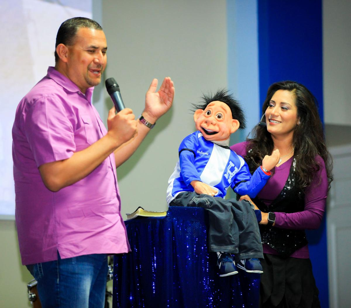 """Arnie and Yoly Pacheco of Ahwatukee and their puppet """"Junior"""" teach lessons of self-esteem in Honduras. Yoly is a bilingual ventriloquist who has brought her show to 16 countries."""